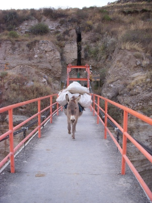 Crossing a bridge in Chivay, Peru