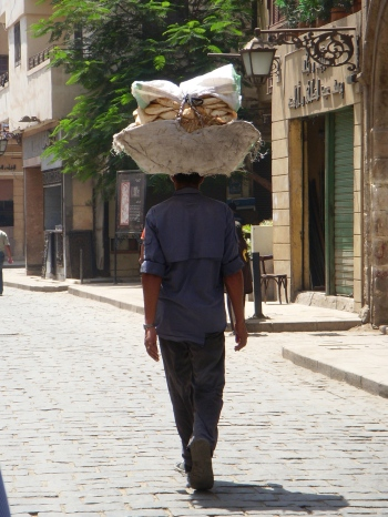 Man carrying bread on his head